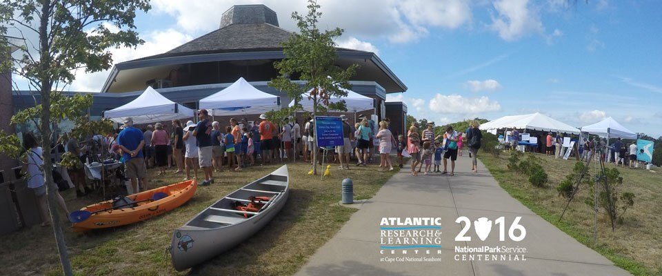 Visitors crowd Science Street Fair exhibits at the Atlantic Research and Learning Center at Cape Cod National Seashore's Centennial event.