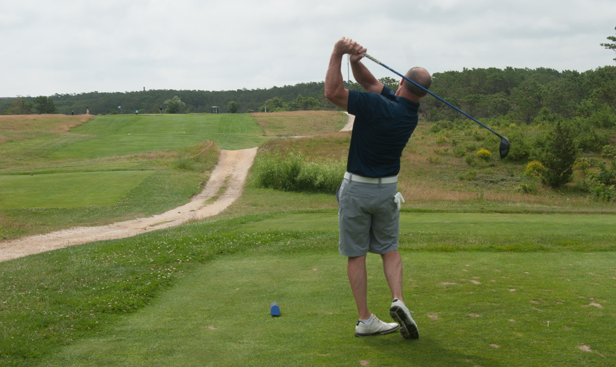 A golfer hits his tee shot at the first hole of Highlands Links Golf Course.