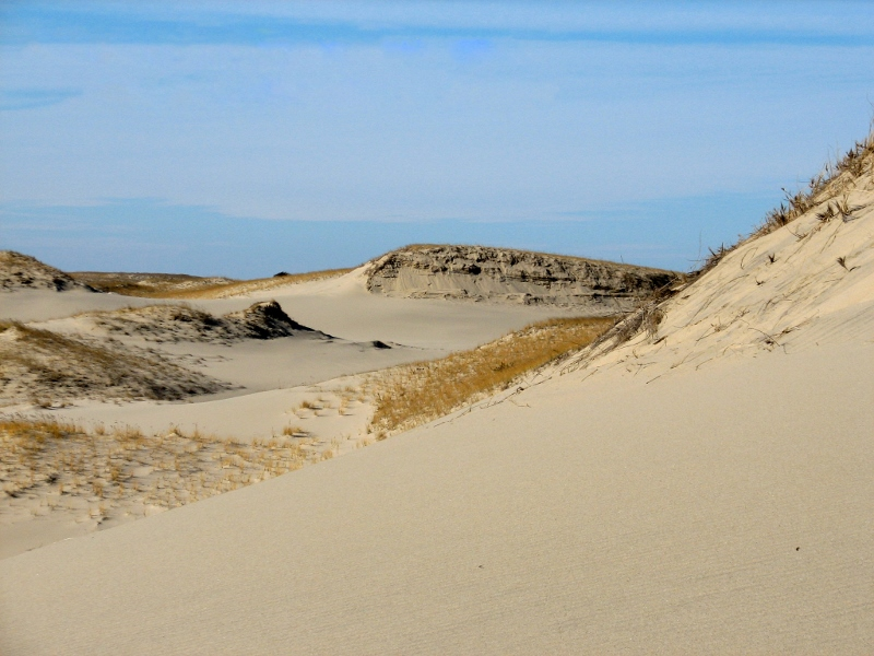 View of sandy dunes and blue sky