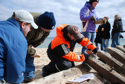 Professor David Robinson (center) and students measuring the wreck.