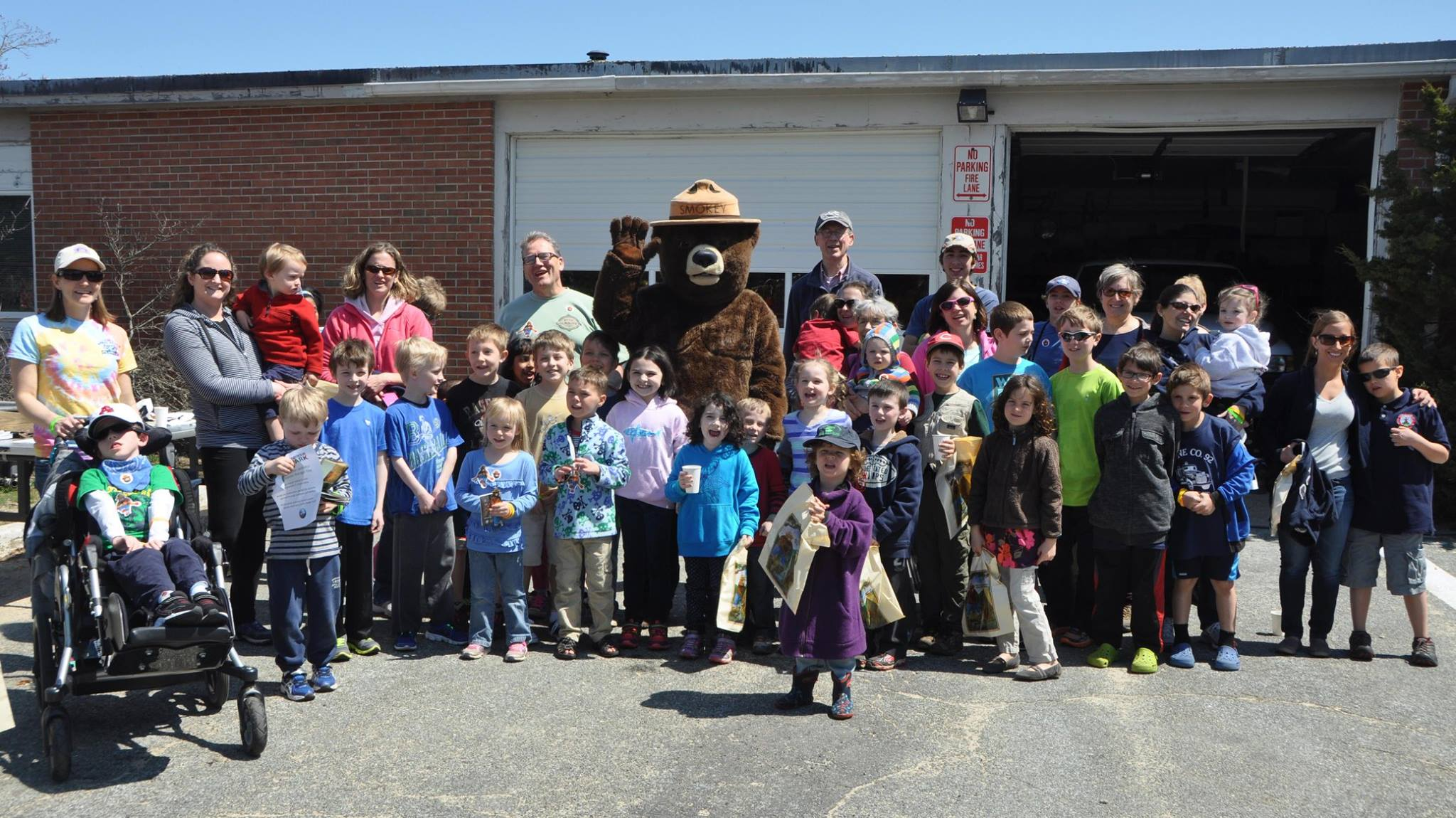 Smoky Bear surrounded by children