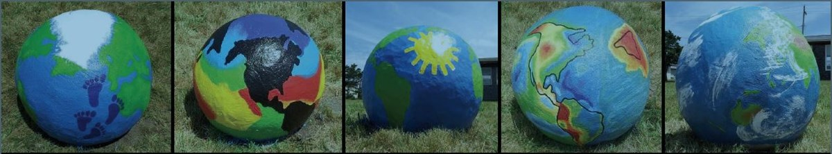 Three colorful concrete globes depicting the earth in different scientific aspects.