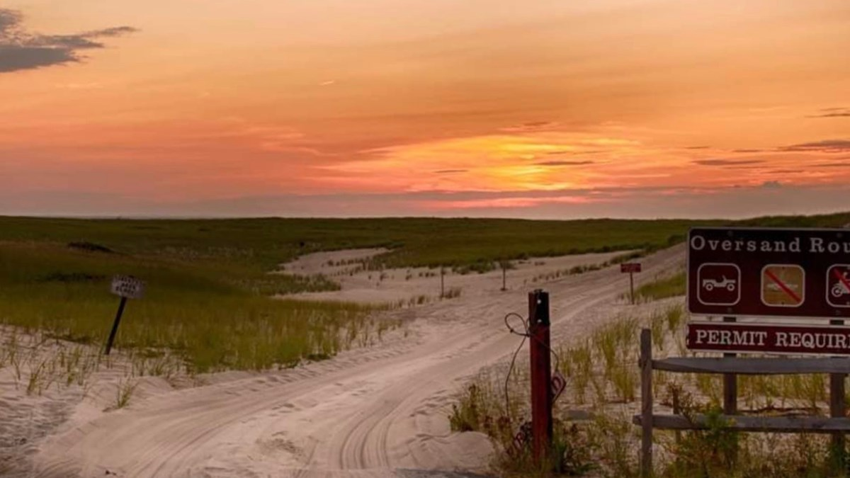 Image of the sunset along the dunes leading out the ORV corridor at the ORV Permit Office in Race Point.