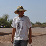 YCC worker in tan Youth Conservation Corp t-shirt and straw hat