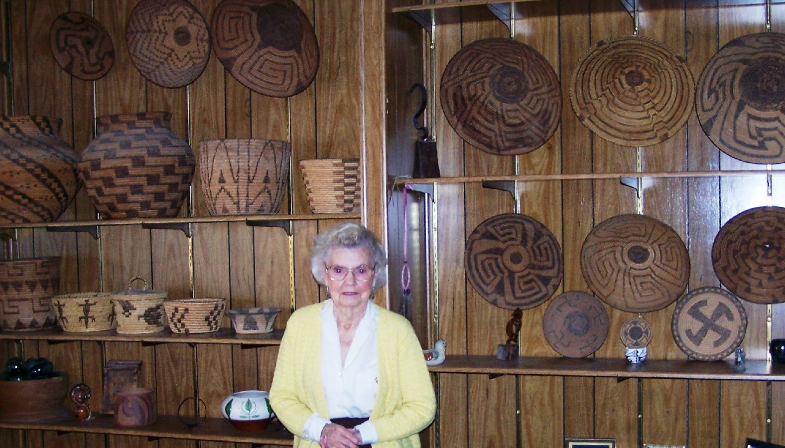Dorothy Fadick with Basket Collection in her home.