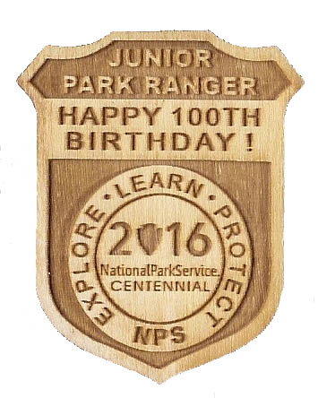 wooden Centennial junior ranger badge for NPS 100 birthday