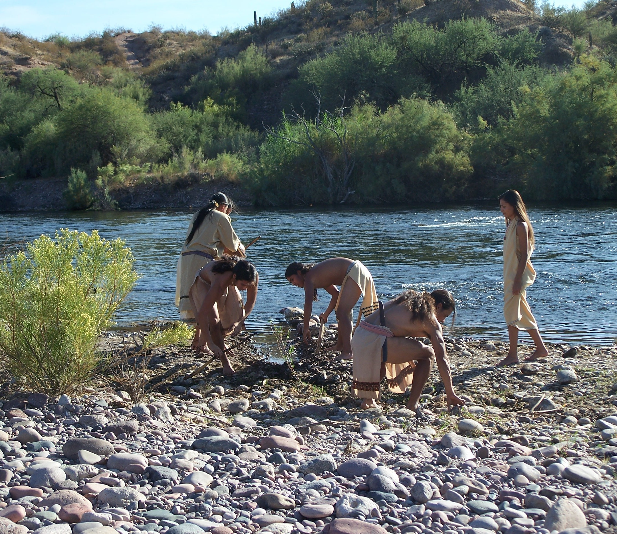 costumed actors are using traditional tools to start a canal at the Salt River