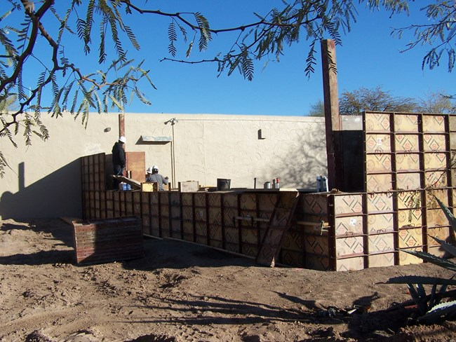 rammed earth construction with wooden frame at different levels