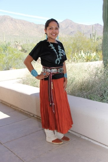 Krishel Augustine wears her fine Navajo jewelry while standing on a desert patio