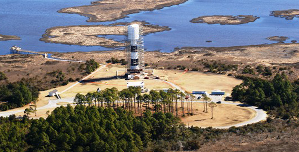 An aerial photograph of the Bodie Island Lighthouse undergoing renovations.