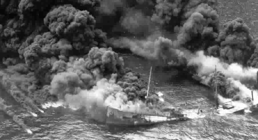 The tanker Byron D. Benson burns off the North Carolina coast, April 3, 1942.