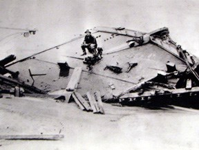 Rasmus Midgett sitting on the wreck of the Priscilla