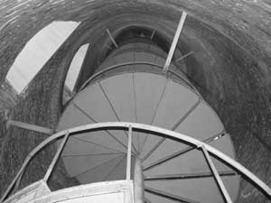 A view inside the Ocracoke Lighthouse shows the stairs spiraling their way to the top.