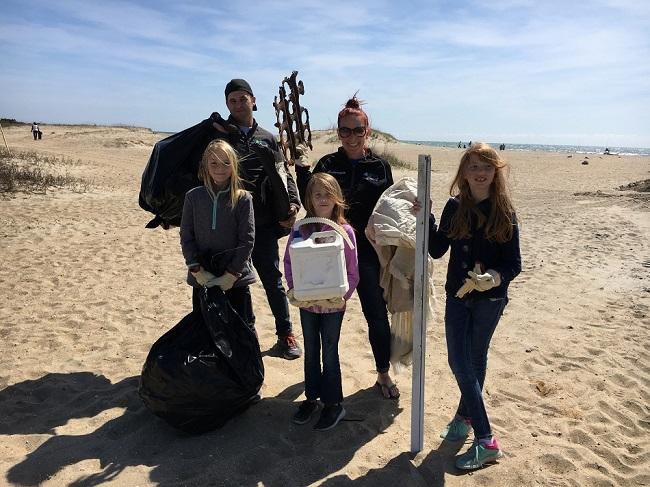 Family of volunteers at a beach cleanup