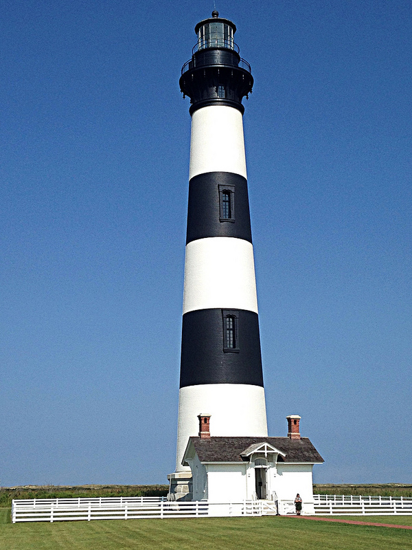 Park Ranger standing in front of Bodie Island Lighthouse.