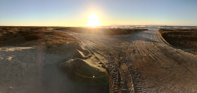 The sandy off-road vehicle routes Inside Road (left) and Beach Access Ramp 48 (right) during sunrise.