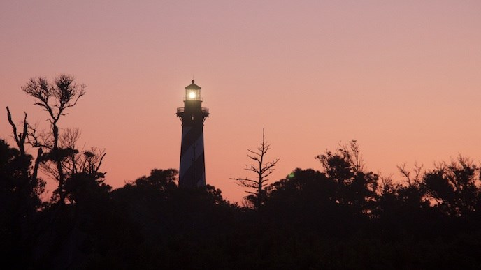 Cape Hatteras Lighthouse light shining at sunrise