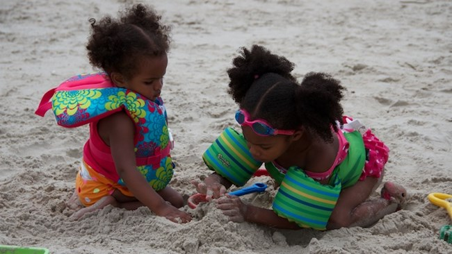 Two kids playing in the sand