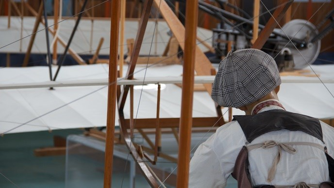 Replicas of the Wright brothers' 1902 glider and 1903 flyer