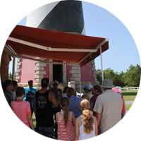 Visitors talking with a ranger before climbing Cape Hatteras Lighthouse