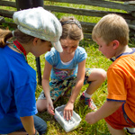 Kids explore a geocache container