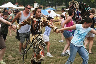 Native dancers invite audience participation in a circle dance during Patuxent Encounters event at Jefferson Patterson Park and Museum, 2007 (Photo by M.Sisler)