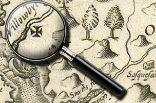 Magnifying glass highlights a cross on Smith's map