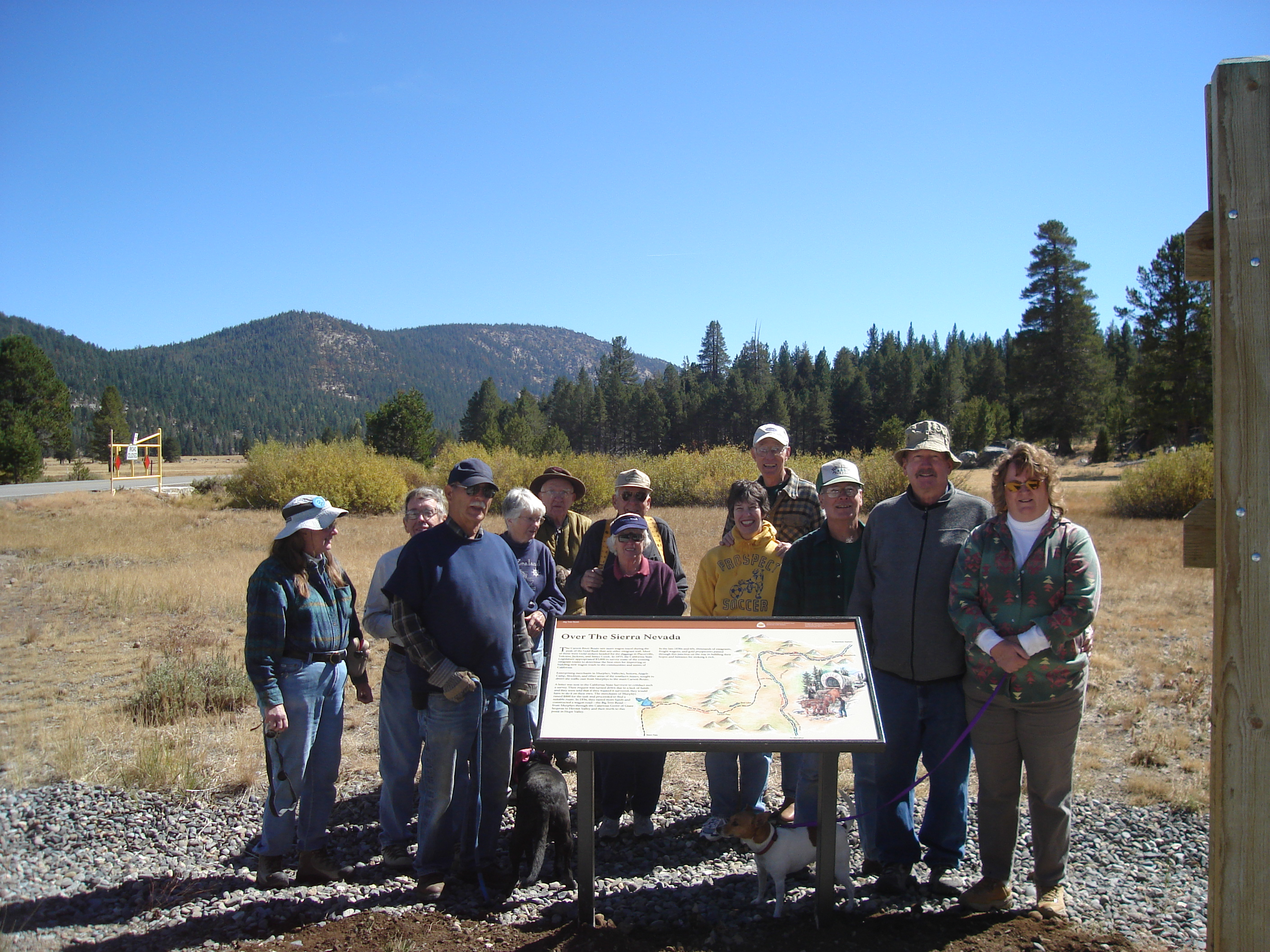 Volunteers from the California-Nevada chapter of the Oregon-California Trails Association (OCTA) complete the installation of a new interpretive exhibit.