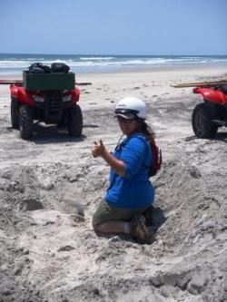 SCA Intern identifying sea turtle nest