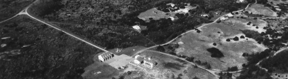 Aerial view of Cape Lookout Village with Coast Guard Station in center.