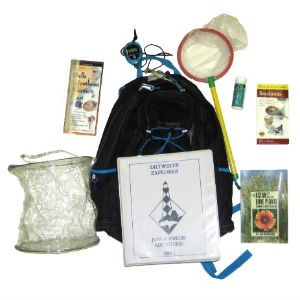 A backpack with books, dip net, and bucket for Saltwater Explorer Junior Ranger Adventure.