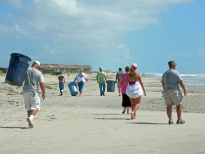 Members of Cape Lookout Mobile Sportfishermen pick up debris from the beach