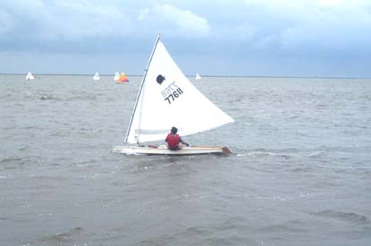 Small sailboat racing in the sound.