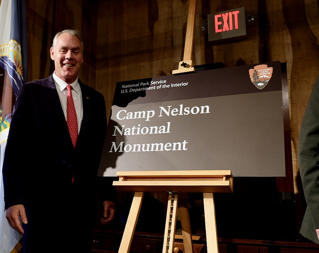 Secretary of the Interior Ryan Zinke and new Camp Nelson National Monument sign