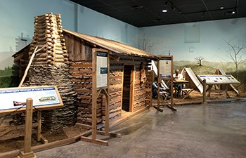 Life size cabin display inside museum exhibits