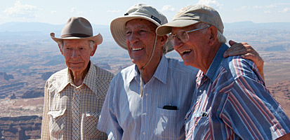 photo: Former Secretary of the Interior Stewart Udall (center) shares a moment with two other Canyonlands pioneers: Kent Frost (left) and Ken Sleight.