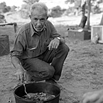 Bates Wilson preparing one of his famous dutch oven breakfasts.
