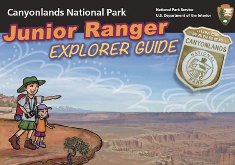 a drawing of two people standing on a cliff edge. text reads junior ranger explorer guide