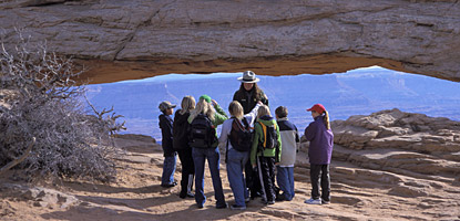 A local school group visits Mesa Arch at the Island in the Sky
