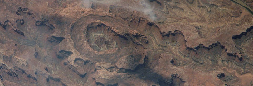 an aerial view of a crater