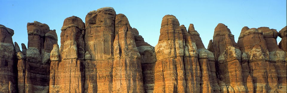 spires of sandstone with horizontal white and orange bands
