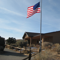 The Island in the Sky Visitor Center with a US flag flying outside.