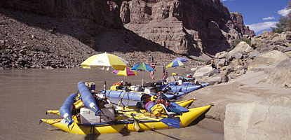 Colorful group at the scouting beach for Big Drop Two in Cataract Canyon