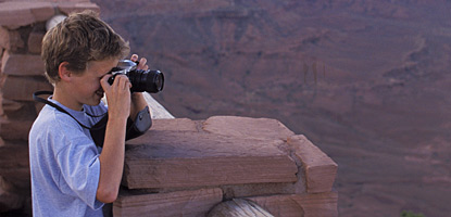 photo: An amateur photographer taking pictures at one of the Island in the Sky's many overlooks