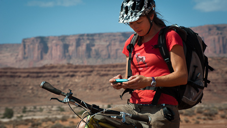 Keeping in touch: a mountain biker sends a few texts near Airport Tower on the White Rim Road.