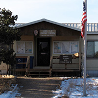 A ranger station with flag flying outside.