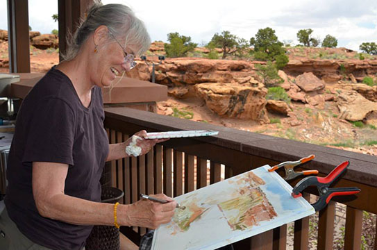 Artist painting scenery at the 2016 Arts and the Park: Light on the Reef event