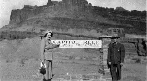 Harriett and Charles Keely stand by the old park entrance sign