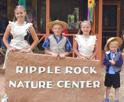 Children at the Ripple Rock Nature Center sign