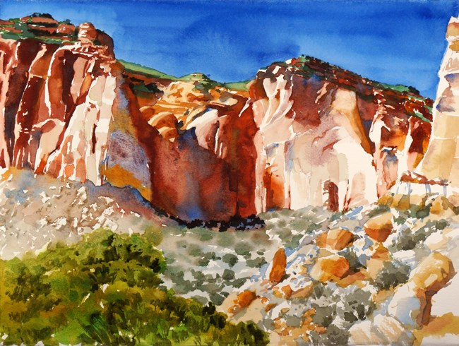 Colorful watercolor painting of red cliffs, blue sky, green vegetation, and tan rocks.